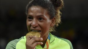 Rio De Janeiro Brazil 08 08 2016 - Rafaela Silva of Brazil bites into her gold medal after winning women s -57kg Final bout of the Rio 2016 Olympic Games Judo events at the Carioca Arena 2 in the Olympic Park in Rio de Janeiro Brazil 08 August 2016 Brasil EFE EPA FACUNDO ARRIZABALAGA